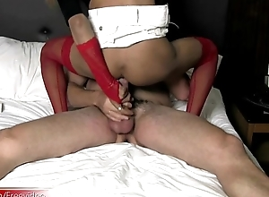Hot ladyboy inserts thick cucumber around the ass and sucks cock