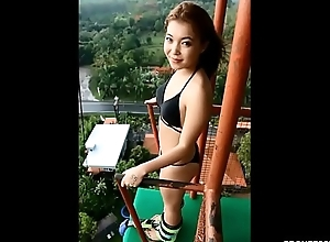 naked asian bungee jumping alongside public